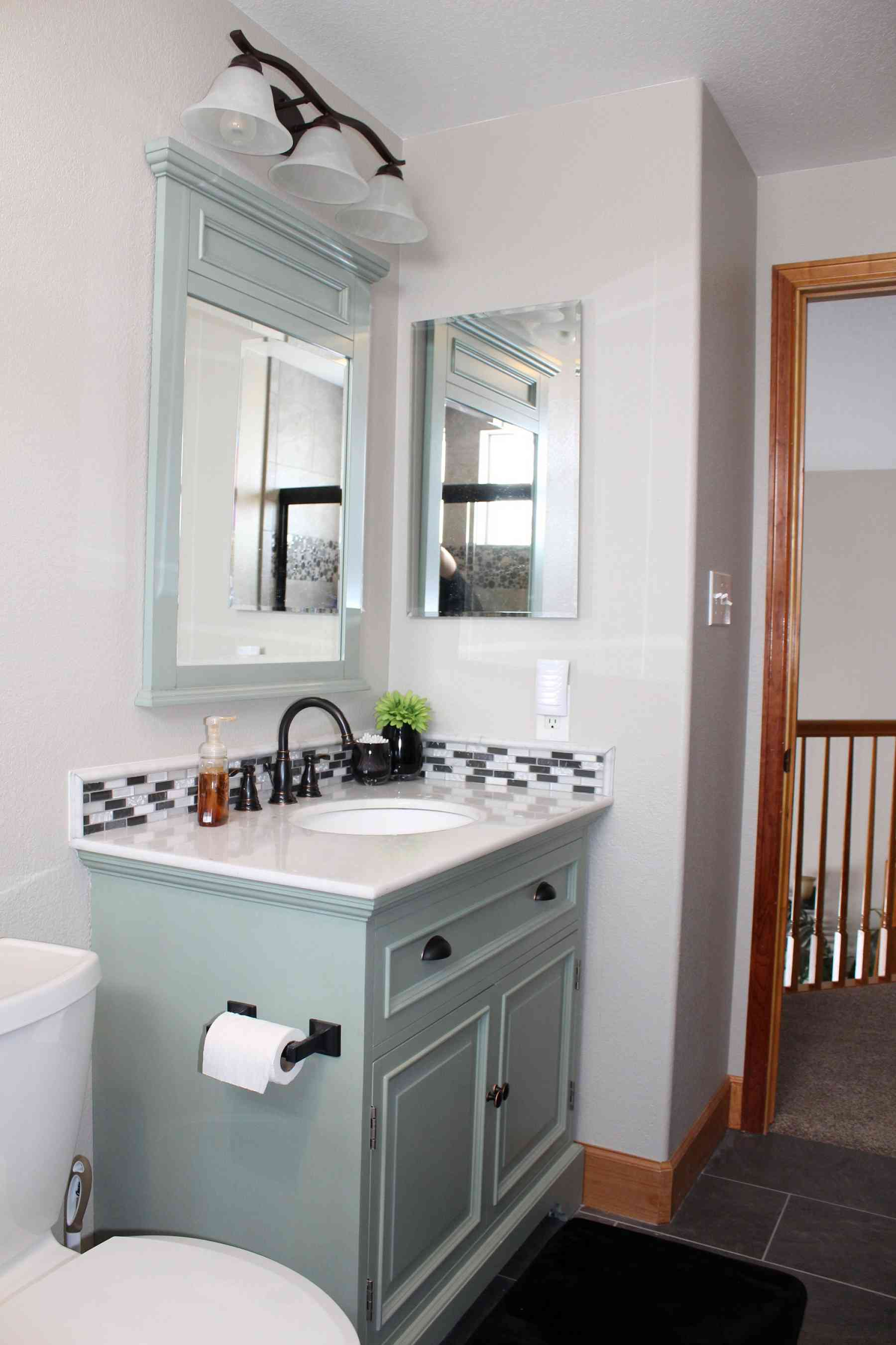 Stunning and updated vanity, backsplash, mirror and light