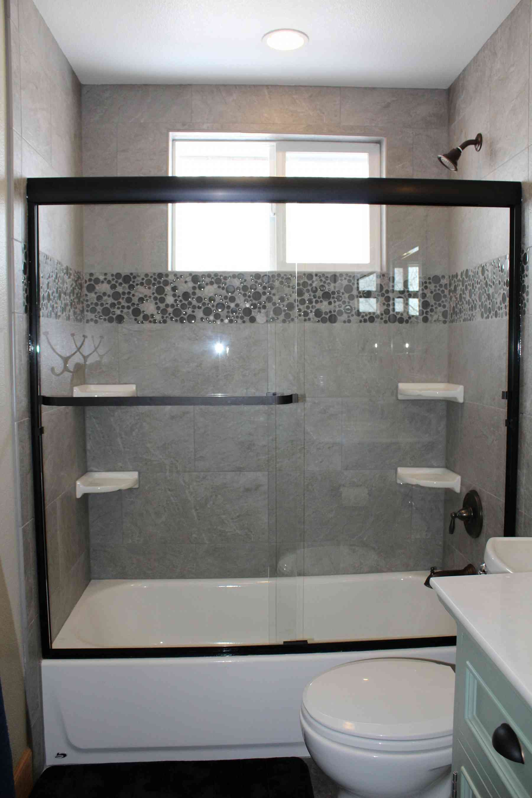 Beautiful new shower tile and sliding glass door!